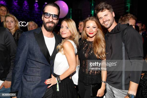 Alec Voelkel member of the band The BossHoss his wife Johanna Voelkel Jana Julie Kilka and Thore Schoelermann attend the Marc Cain Fashion Show...