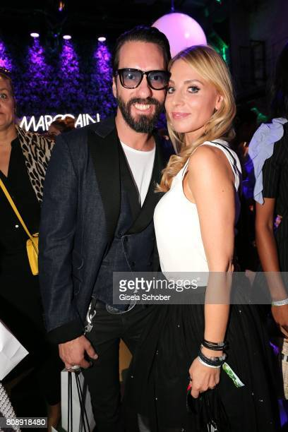 Alec Voelkel member of 'The Boss Hoss' and his wife Johanna Voelkel during the Marc Cain Fashion Show Spring/Summer 2018 at ewerk on July 4 2017 in...