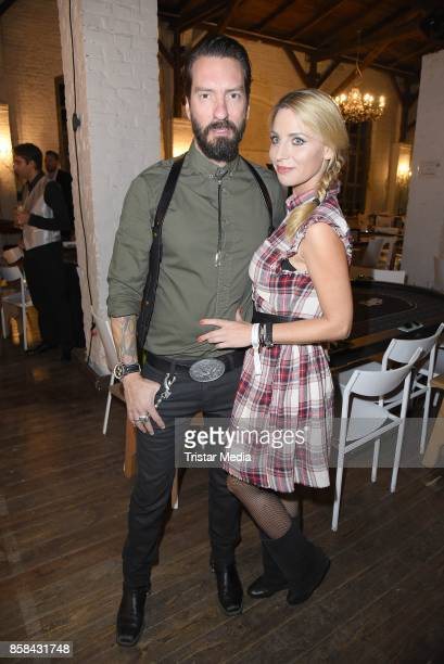 Alec Voelkel of the band The BossHoss and his wife Johanna Michels attend the 'CMS Gamblers Night Western Style' of Christoph Metzelder Foundation on...