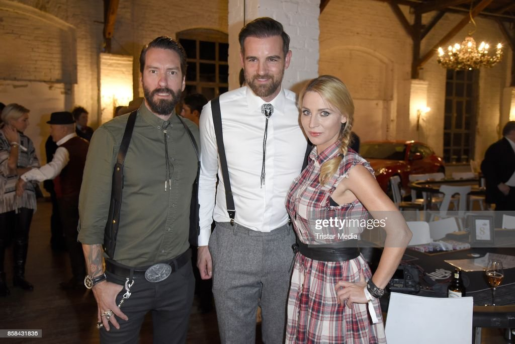 Alec Voelkel of the band The BossHoss, his wife Johanna Michels and Christoph Metzelder attend the 'CMS Gamblers Night - Western Style' of Christoph Metzelder Foundation on October 6, 2017 in Berlin, Germany.