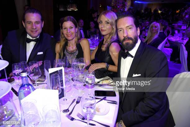 Alec Voelkel of the band The BossHoss his wife Johanna Michels Sascha Vollmer of the band The BossHoss and his girlfriend Jenny Stock attend the...