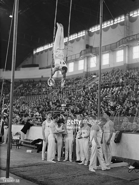 Alec Wales of Great Britain on the rings at Empress Hall Earl's Court during the gymnastics events at the London Olympic Games 12th August 1948...