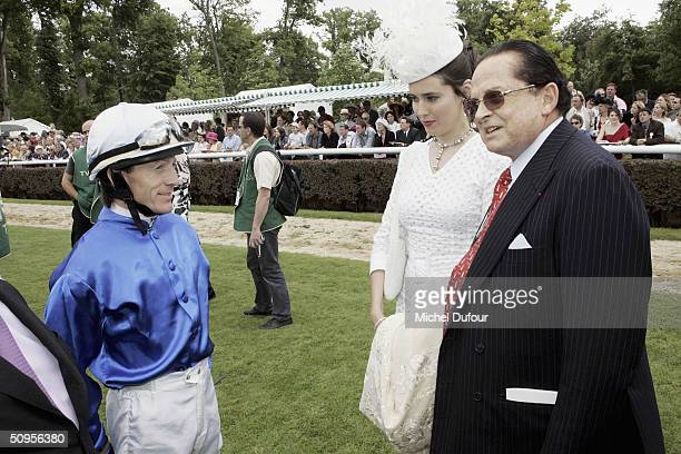 Alec Wildenstein with wife and jockey Kieren Fallon attend the Prix de Diane Hermes on June 13 2004 in Chantilly France