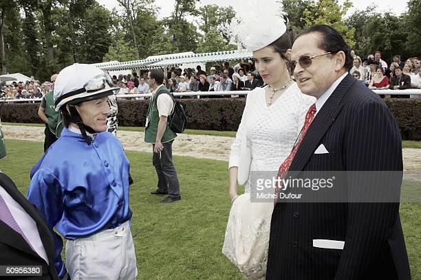 Alec Wildenstein with wife and jockey Kieren Fallon attend the Prix de Diane Hermes on June 13 2004 in Chantilly France