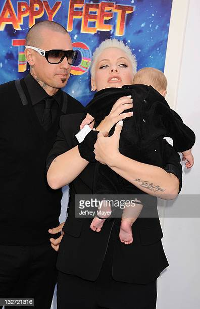 Alecia Beth Moore Willow Sage Hart and Carey Hart attend the 'Happy Feet Two' Los Angeles Premiere at Grauman's Chinese Theatre on November 13 2011...