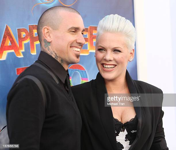 Alecia 'Pink' Moore and Carey Hart arrive at the Los Angeles premiere of 'Happy Feet Two' held at Grauman's Chinese Theatre on November 13 2011 in...