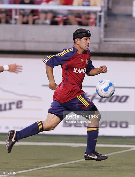 Alecko Eskandarian of the Real Salt Lake runs with the ball against the Chicago Fire at Rice-Eccles Stadium on August 18, 2007 in Salt Lake City,...