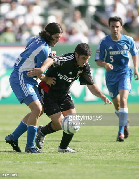 Alecko Eskandarian#11 of the DC United dribbles against the defense of Nick Garcia of the Kansas City Wizards to score his first goal during the MLS...