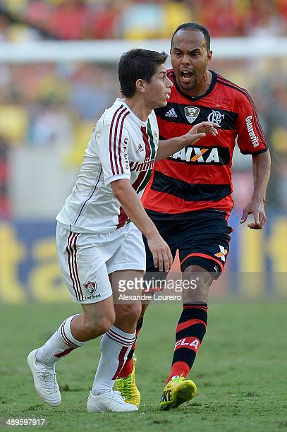 Alecsandro of Flamengo yells at Conca of Fluminense during the match between Fluminense and Flamengo as part of Brasileirao Series A 2014 at Maracana...
