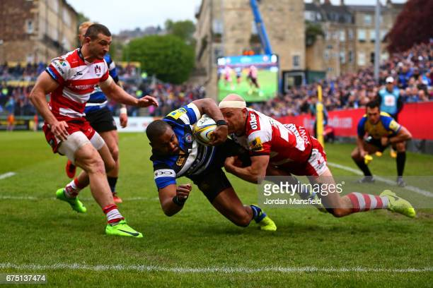 Aled Brew of Bath dives to touch down a try during the Aviva Premiership match between Bath Rugby and Gloucester Rugby at the Recreation Ground on...