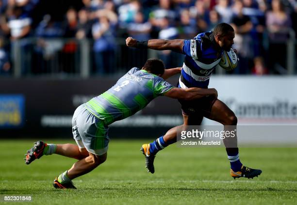 Aled Brew of Bath is tackled by Santiago Socino of Newcastle during the Aviva Premiership match between Bath Rugby and Newcastle Falcons at...