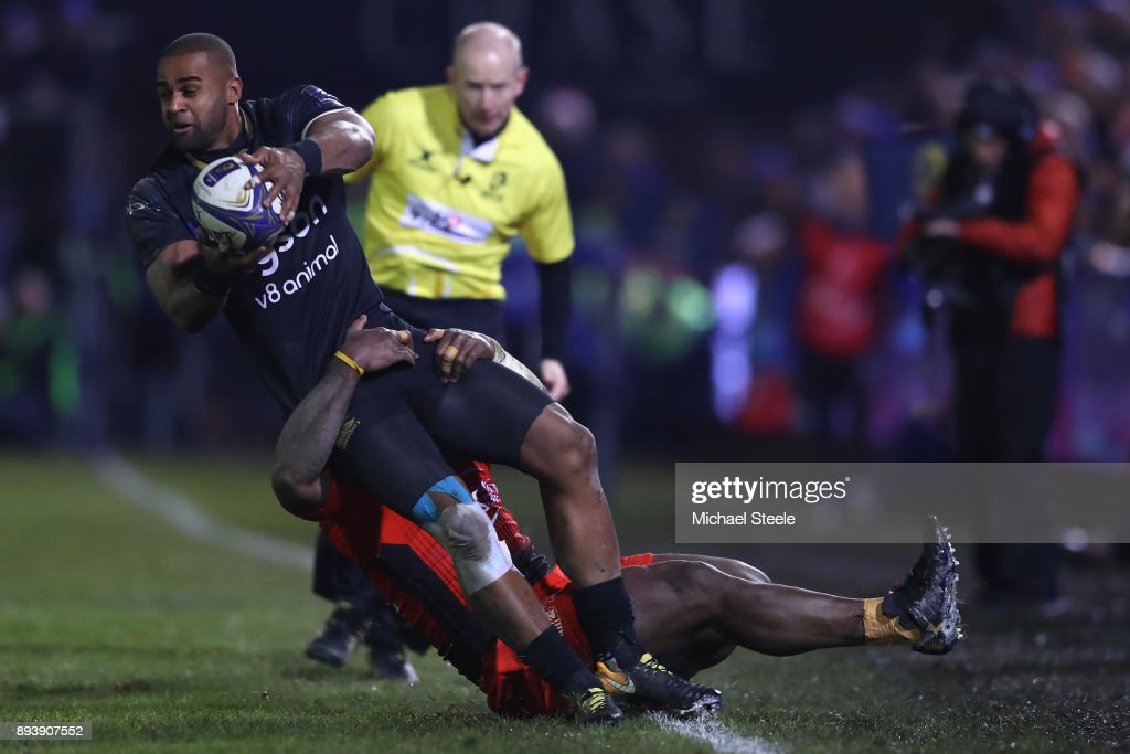 Aled Brew of Bath looks for support as he is tackled by Tuisova Josua of Toulon during the European Rugby Champions Cup match between Bath Rugby and RC Toulon at Recreation Ground on December 16, 2017 in Bath, England.