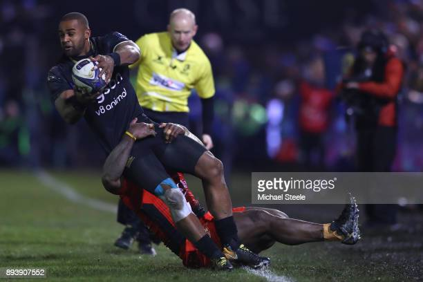 Aled Brew of Bath looks for support as he is tackled by Tuisova Josua of Toulon during the European Rugby Champions Cup match between Bath Rugby and...