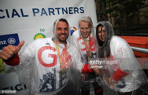 Aled Davies Jonnie Peacock and Julie Rogers pose during a Rio 2016 Victory Parade for the British Olympic and Paralympic teams on October 17 2016 in...