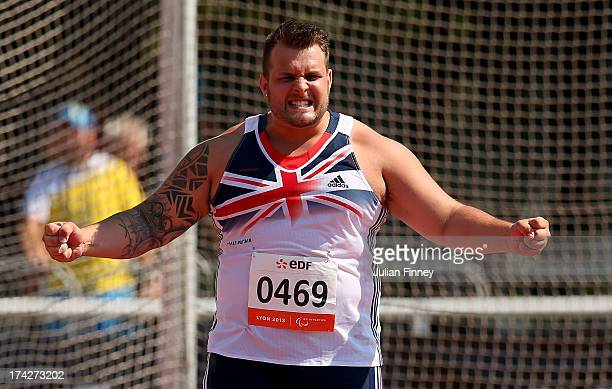 Aled Davies of Great Britain celebrates his World Record throw in the Men's Discus F42 during day four of the IPC Athletics World Championships on...