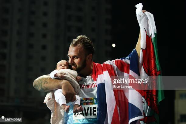 Aled Davies of Great Britain celebrates with his daughter after winning the Men's F63 Shot Put on Day Four of the IPC World Para Athletics...