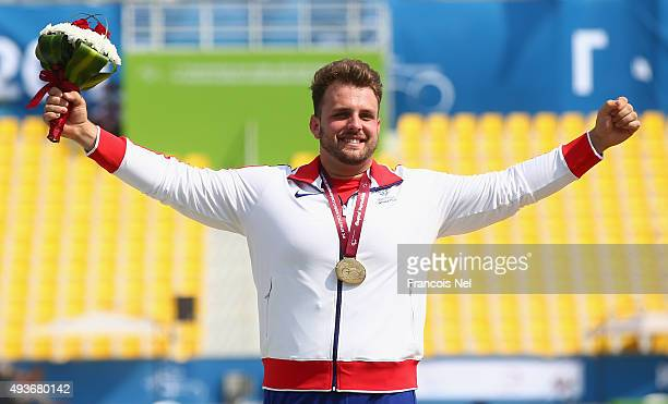 Aled Davies of Great Britain poses with his gold medal at the medal ceremony for the Men's Shot Put F42 Final during the Morning Session on Day One...