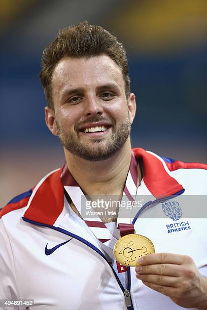 Aled Davies of Great Britain poses with his gold medal for the men's discus F42 final during the Evening Session on Day Seven of the IPC Athletics...