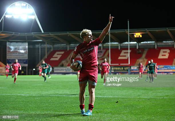 Aled Davies of Scarlets celebrates his try during the European Rugby Champions Cup match between Scarlets and Leicester Tigers at Parc y Scarlets on...