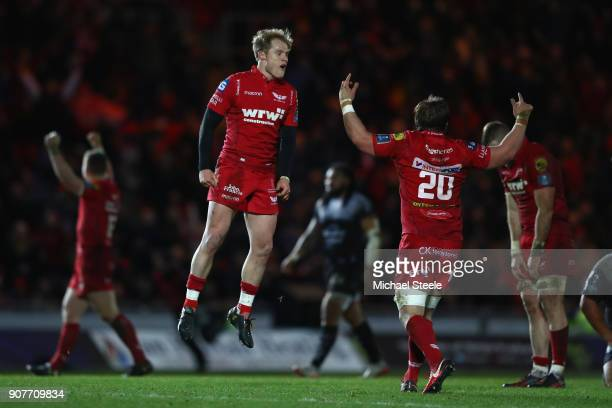 Aled Davies of Scarlets leaps into the as he celebrates at the final whistle and his sides 3027 victory with Will Boyde during the European Rugby...
