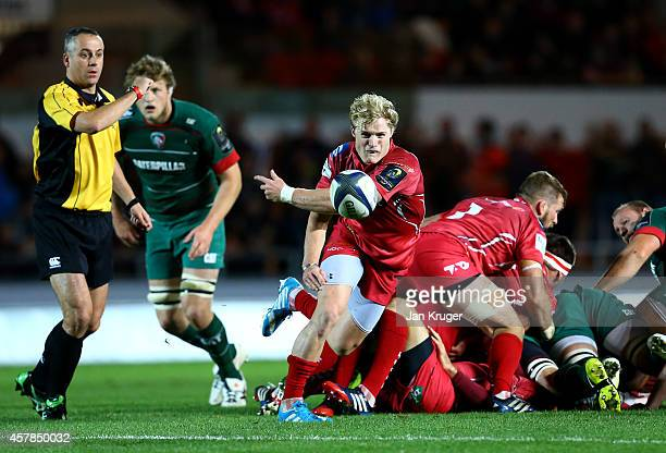 Aled Davies of Scarlets spins the ball out during the European Rugby Champions Cup match between Scarlets and Leicester Tigers at Parc y Scarlets on...