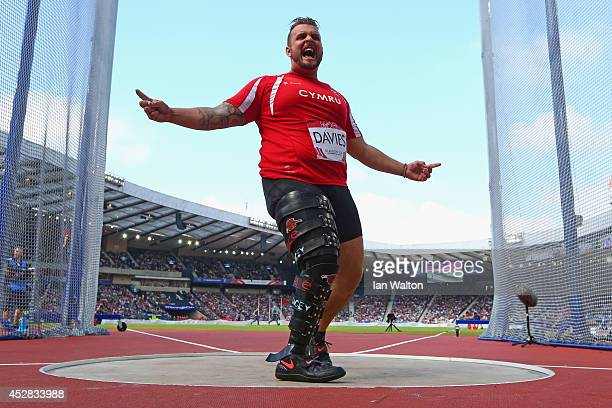 Aled Davies of Wales celebrates as he competes in the Men's F42/44 Discus final at Hampden Park Stadium during day five of the Glasgow 2014...