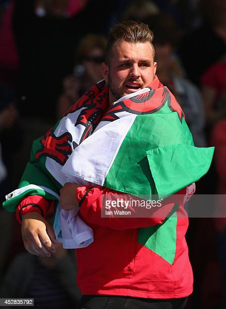 Aled Davies of Wales celebrates as he wins silver in the Men's F42/44 Discus final at Hampden Park Stadium during day five of the Glasgow 2014...