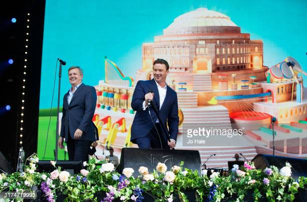Aled Jones and Russell Watson perform on stage during BBC Proms In The Park 2019 at Hyde Park on September 14 2019 in London England