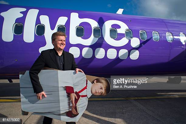 Aled Jones departs a FLYBE flight after launching his new Christmas album 'One Voice At Christmas' where he performed Walking In The Air and...