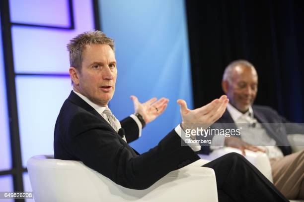Aled Miles chief executive officer of TeleSign Corp left speaks as John Thompson chief executive officer of Virtual Instruments Corp and chairman of...