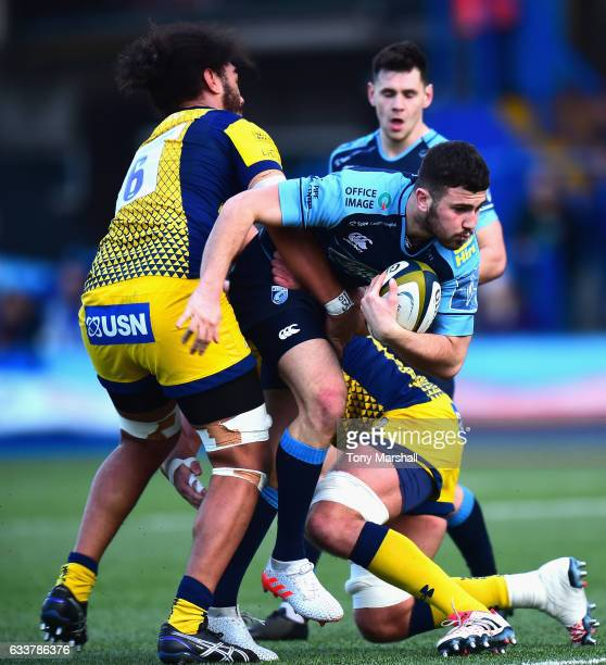 Aled Summerhill of Cardiff Blues is tackled by Chris Vui and Darren Barry of Worcester Warriors during the AngloWelsh Cup match between Cardiff Blues...