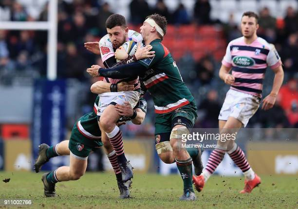 Aled Summerhill of Cardiff is tackled by Will Evans of Leicester Tigers during the AngloWelsh Cup match between Leicester Tigers and Cardiff Blues at...