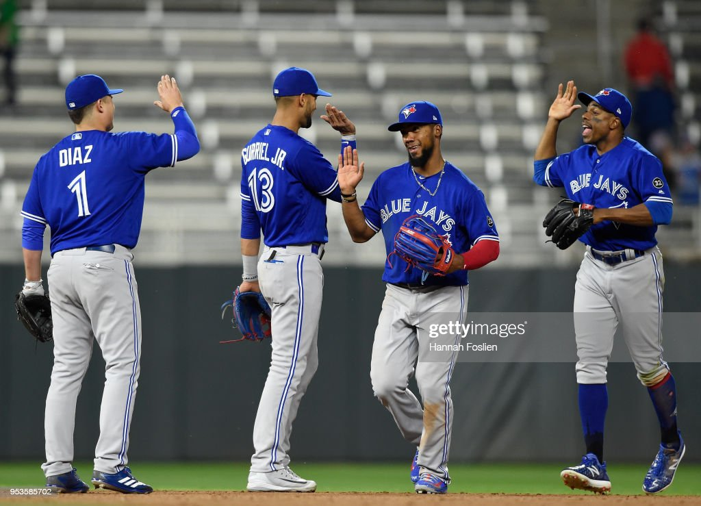 Aledmys Diaz #1, Lourdes Gurriel #13, Teoscar Hernandez #37 and Curtis Granderson #18 of the Toronto Blue Jays celebrate a win against the Minnesota Twins in 10 innings on May 1, 2018 at Target Field in Minneapolis, Minnesota. The Blue Jays defeated the Twins 7-4.