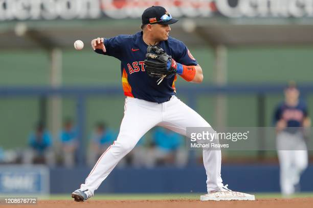 Aledmys Diaz of the Houston Astros drops the ball as he attempts to turn a double play in the fourth inning against the Miami Marlins during a...
