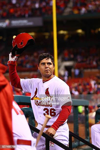 Aledmys Diaz of the St Louis Cardinals acknowledges the crowd after hitting a solo home run against the Philadelphia Phillies in the sixth inning at...