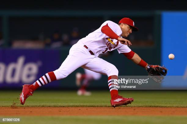 Aledmys Diaz of the St Louis Cardinals attempts to field a ground ball against the Milwaukee Brewers in the eighth inning at Busch Stadium on May 1...