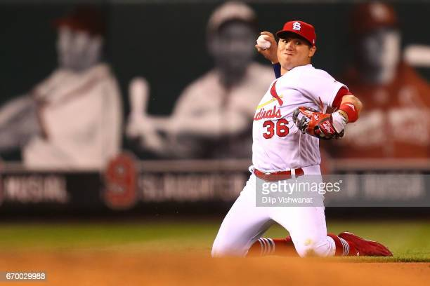 Aledmys Diaz of the St Louis Cardinals attempts to throw a runner out against the Pittsburgh Pirates in the ninth inning at Busch Stadium on April 18...