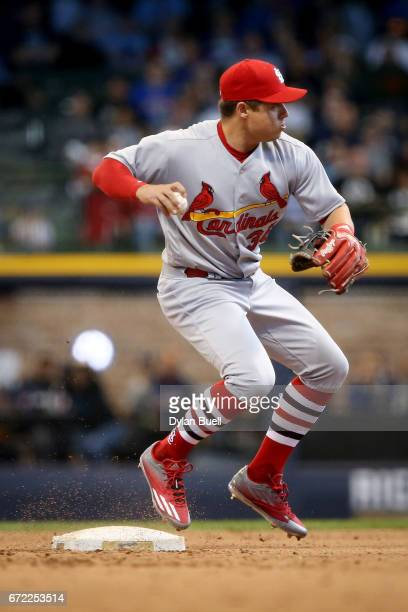 Aledmys Diaz of the St Louis Cardinals attempts to turn a double play in the fourth inning against the Milwaukee Brewers at Miller Park on April 23...