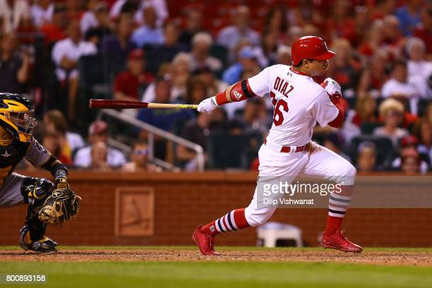 Aledmys Diaz of the St Louis Cardinals bats in a run on a fielding error against the Pittsburgh Pirates in the seventh inning at Busch Stadium on...