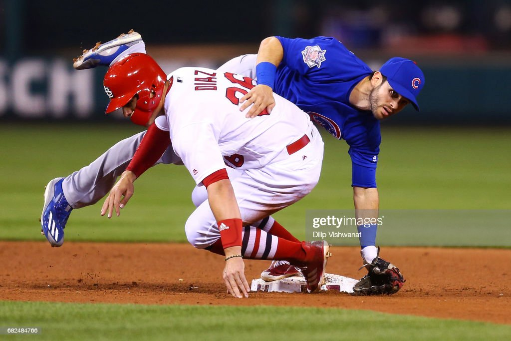 Aledmys Diaz #36 of the St. Louis Cardinals breaks up a double play against Tommy La Stella #2 of the Chicago Cubs in the fourth inning at Busch Stadium on May 12, 2017 in St. Louis, Missouri.