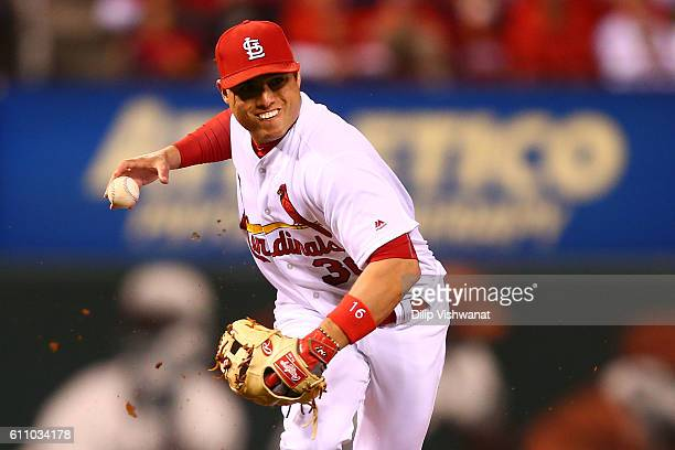 Aledmys Diaz of the St Louis Cardinals can't hold on to the ball while trying to throw out a runner against the Cincinnati Reds in the second inning...