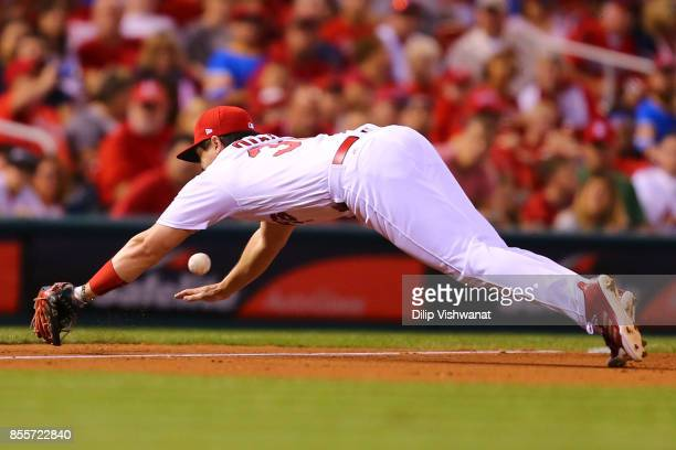 Aledmys Diaz of the St Louis Cardinals dives for a ground ball against the Milwaukee Brewers in the sixth inning at Busch Stadium on September 29...