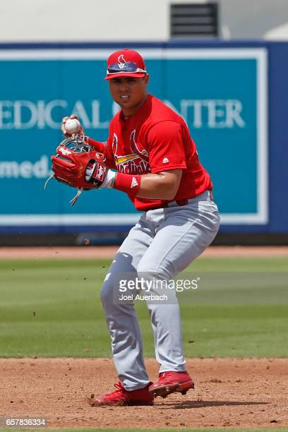Aledmys Diaz of the St Louis Cardinals fields the ball hit by Trea Turner of the Washington Nationals during a spring training game at The Ballpark...