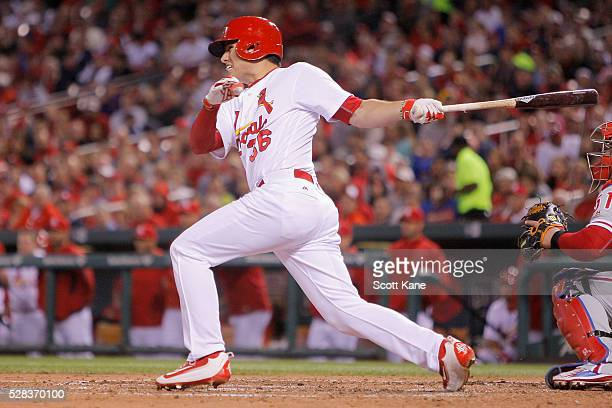 Aledmys Diaz of the St Louis Cardinals follows through on a two RBI single during the fifth inning against the Philadelphia Phillies at Busch Stadium...