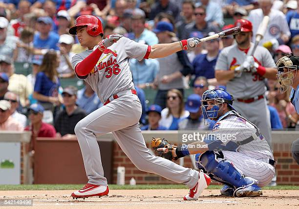 Aledmys Diaz of the St Louis Cardinals hits a single in the first inning against the Chicago Cubs at Wrigley Field on June 22 2016 in Chicago Illinois