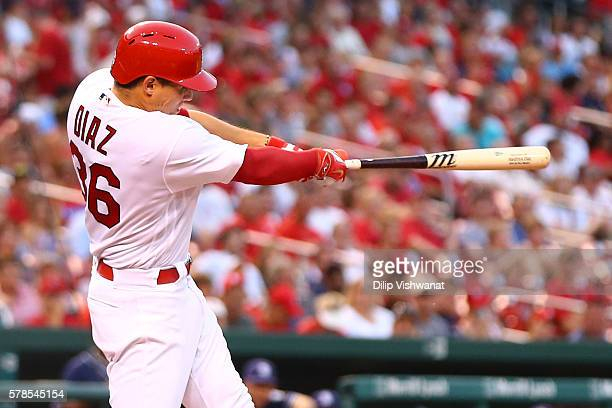 Aledmys Diaz of the St Louis Cardinals hits an RBI single against San Diego Padres in the sixth inning at Busch Stadium on July 21 2016 in St Louis...