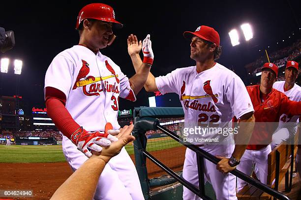 Aledmys Diaz of the St Louis Cardinals is congratulated by manager Mike Matheny of the St Louis Cardinals after hitting a tworun home run against the...