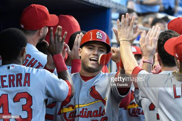 Aledmys Diaz of the St Louis Cardinals is congratulated by teammates after scoring on a RBI double by Carlos Martinez against the Miami Marlins at...