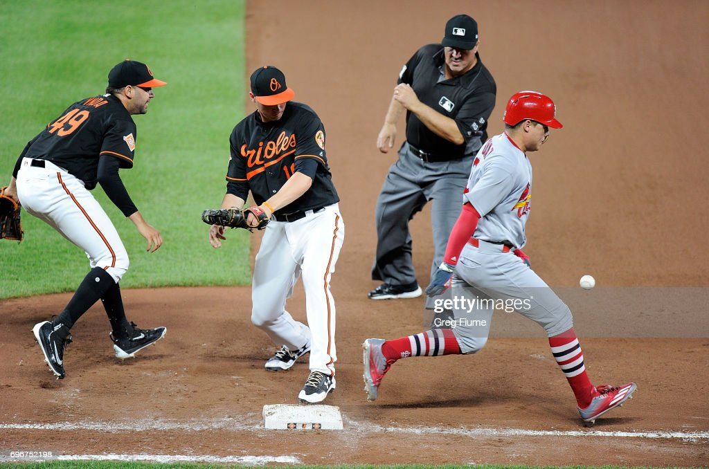 Aledmys Diaz #36 of the St. Louis Cardinals is safe at first base in the seventh inning on an error by Gabriel Ynoa #49 of the Baltimore Orioles at Oriole Park at Camden Yards on June 16, 2017 in Baltimore, Maryland.
