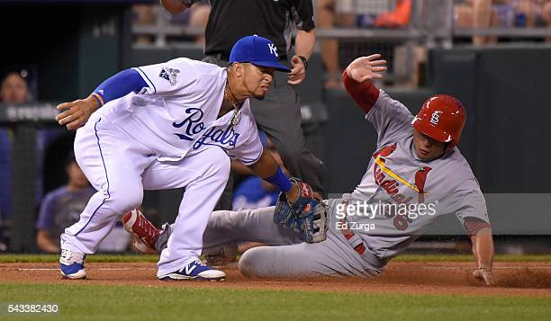 Aledmys Diaz of the St Louis Cardinals is tagged out by Cheslor Cuthbert of the Kansas City Royals as he tries to steal third in the sixth inning at...